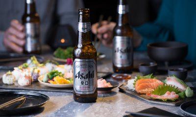 Asahi Super Dry con sushi sashimi